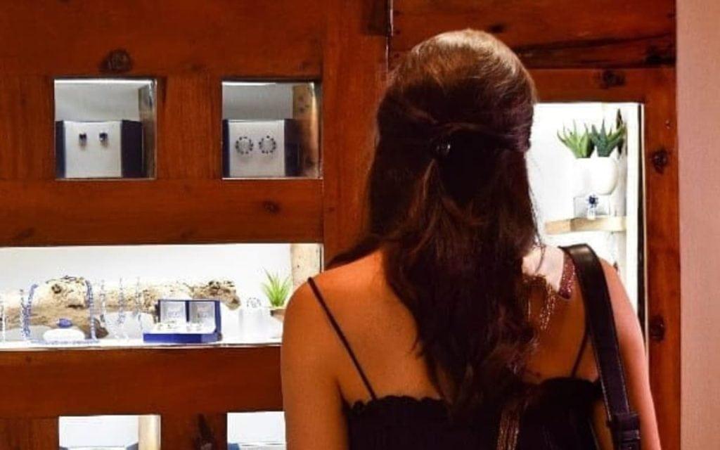 Woman looking to buy Tanzanite at The Tanzanite Experience Shop