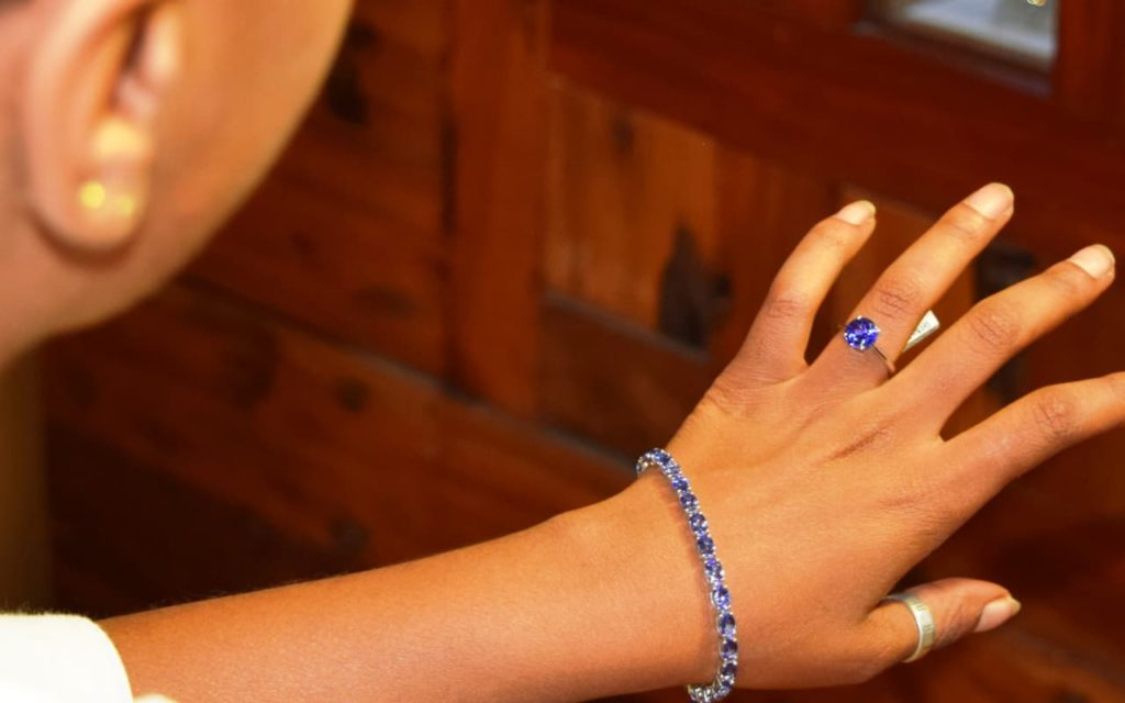 A woman wearing a Tanzanite engagement ring