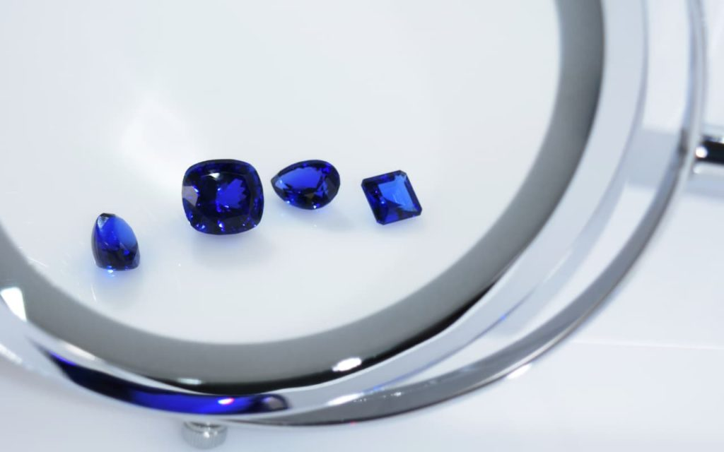 Tanzanite stones under a magnifying glass